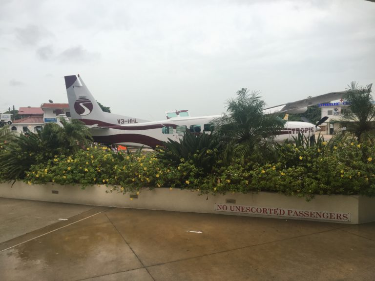 Waiting in the rain to fly to Corozal